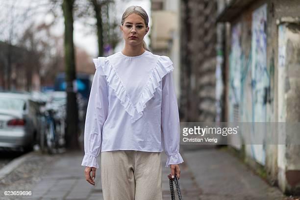 Daniela Breithaupt wearing beige pants PullBear white blouse vintage black boots Asos vintage glasses black Gucci bag on November 16 2016 in Berlin...