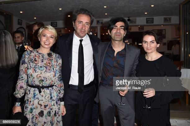 Daniela D'Antonio Paolo Sorrentino Faith Aktin and Christina Bazdekis attend Fondazione Prada Private Dinner during the 70th annual Cannes Film...
