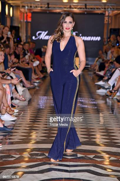 Daniela Dany Michalski walks the runway at the Fashion2Show show during the Berlin Fashion Week Spring/Summer 2019 at Quartier 206 on July 5 2018 in...