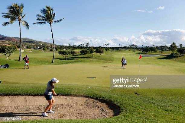 Daniela Darquea of Ecuador chips from the bunker onto the first green during the second round of the LPGA LOTTE Championship at Kapolei Golf Club on...