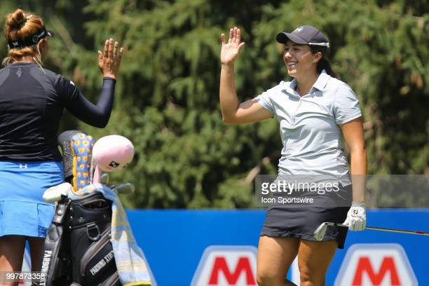 Daniela Darquea of Ecuador receives congratulations from playing partner Alison Lee after scoring a holeinone on the sixth hole during the second...