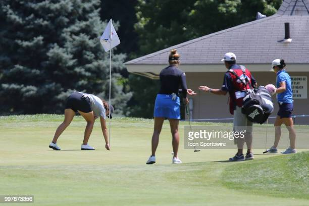Daniela Darquea of Ecuador retrieves her ball from the cup on the sixth green after scoring a holeinone during the second round of the LPGA Marathon...