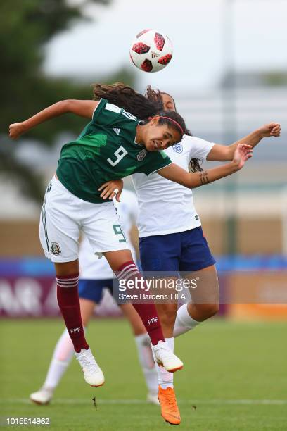 Daniela Espinosa of Mexico wins a header from Mayumi Pacheco of England during the group B match between England and Mexico at Stade de Marville on...