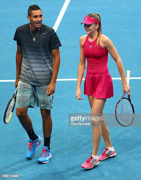 Daniela Hantuchova and substitute player Nick Kyrgios of the Singapore Slammers discuss tatics against Kristina Mladenovic and Nenad Zimonjic of the...