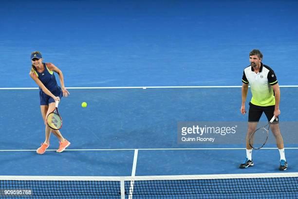 Daniela Hantuchova of Slovakia and Goran Ivanisevic of Croatia compete in their mixed doubles match against Alicia Molik of Australia and Mark...