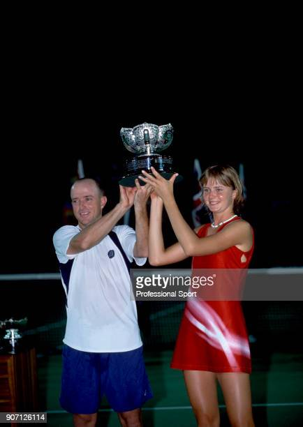 Daniela Hantuchova of Slovakia and Kevin Ullyett of Zimbabwe lift the trophy after defeating Paolo Suarez and Gaston Etlis both of Argentina in the...
