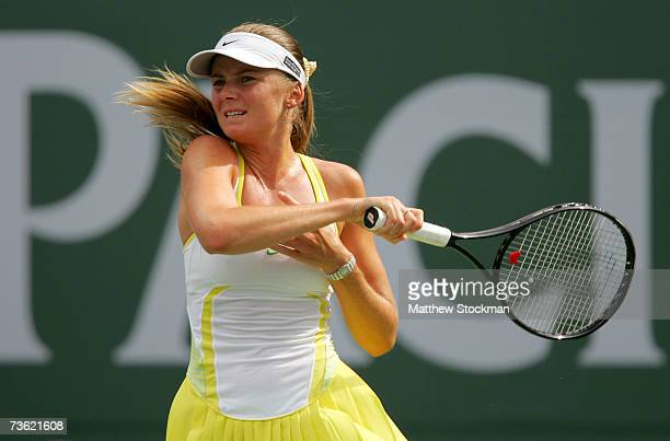 Daniela Hantuchova of Slovakia follows through on a shot to Svetlana Kuznetsova of Russia in the final of the Pacific Life Open on March 17 2007 at...