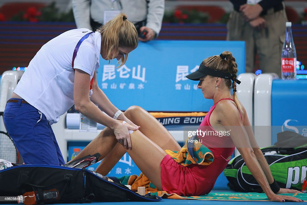 Daniela Hantuchova of Slovakia (Right) gives up the match because of injury during her match against Svetlana Kuznetsova of Russia during day two of the China Open at the China National Tennis Center on September 28, 2014 in Beijing, China.