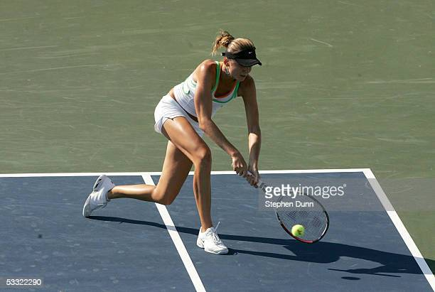 Daniela Hantuchova of Slovakia hits a backhand against Nathalie Dechy of France and Francesca Schiavone of Italy during the Acura Classic at the La...