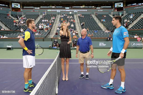 Daniela Hantuchova of Slovakia performs the coin toss before Ryan Harrison plays Federico Delbonis of Argentina during the BNP Paribas Open at the...