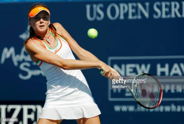 Daniela Hantuchova of Slovakia plays a backhand against Patty Schnyder of Switzerland during the Pilot Pen Tennis tournament August 24 2005 at the...
