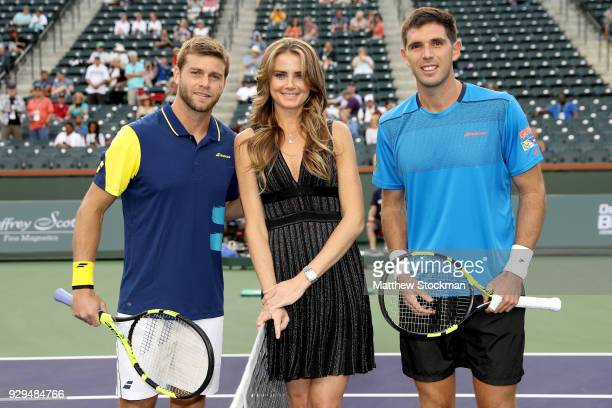 Daniela Hantuchova of Slovakia poses with Ryan Harrison plays Federico Delbonis of Argentina after performing the coing toss during the BNP Paribas...