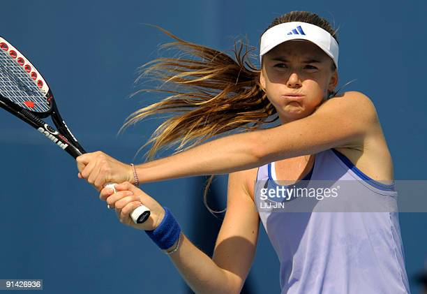 Daniela Hantuchova of Slovakia returns a shot against Carla Suarez Navarro of Spain during their match of the China Open at the National Tennis...