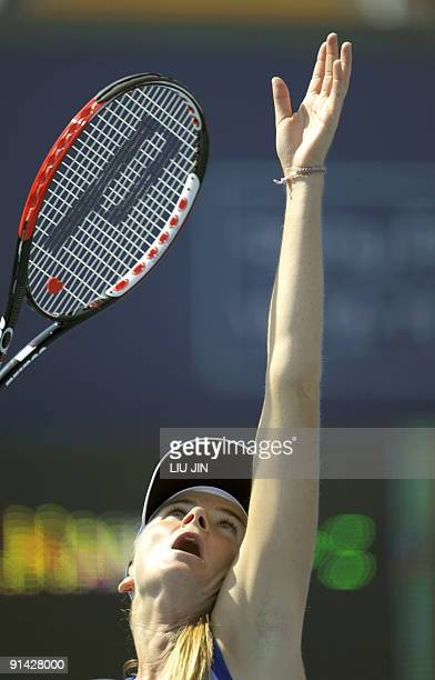 Daniela Hantuchova of Slovakia serves to Carla Suarez Navarro of Spain during their match of the China Open at the National Tennis Center in Beijing...