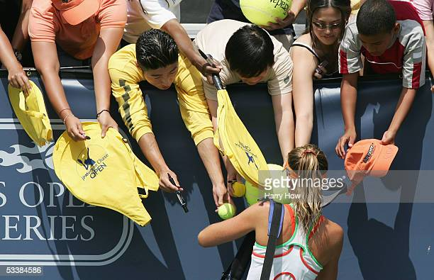 Daniela Hantuchova of Slovakia signs autographs for fans after defeating Elena Dementieva of Russia in the JPMorgan Chase Open semifinals at The Home...