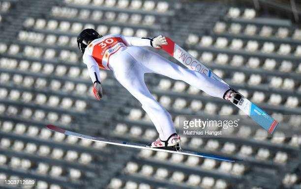 Daniela Haralambie of Romania in action in front of empty seats on the tribune during the Women's Ski Jumping Normal Hill training at the FIS Nordic...