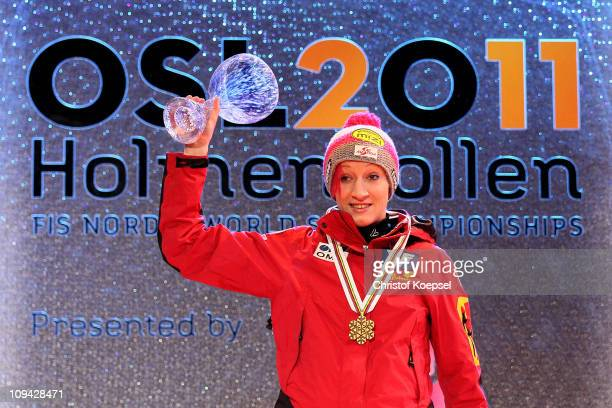 Daniela Iraschko of Austria celebrates with the gold medal won in the Ladies Ski Jumping Individual HS106 competition during the FIS Nordic World Ski...