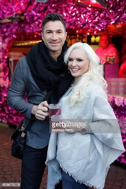 Daniela Katzenberger and her husband Lucas Cordalis pose during the 'Daniela Katzenberger mit Lucas im Weihnachtsfieber' photocall at Christmas...