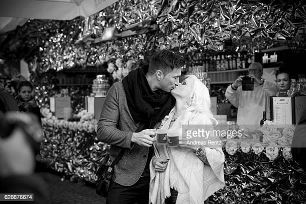 Daniela Katzenberger kisses her husband Lucas Cordalis during the 'Daniela Katzenberger mit Lucas im Weihnachtsfieber' photocall at Christmas Avenue...