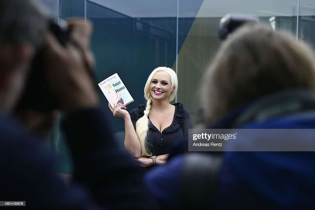 Daniela Katzenberger poses for a photograph during the launch of her new book 'Eine Tussi wird Mama' on October 13, 2015 in Cologne, Germany.
