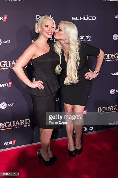 Daniela Katzenberger with sister Jennifer Frankhauser attend the 'Bodyguard Das Musical' gala premiere at Musical Dome Koeln on November 21 2015 in...