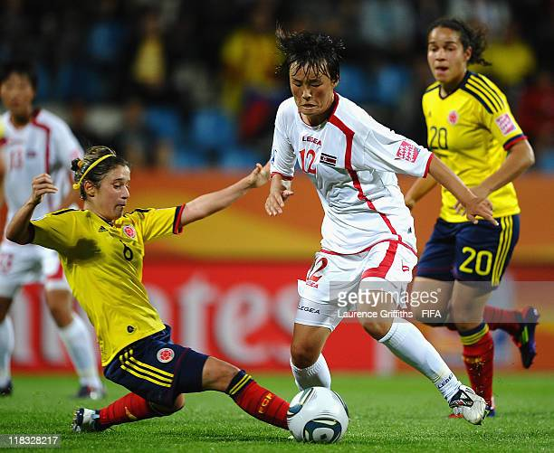 Daniela Montoya of Colombia battles with Jon Myong Hwa of Korea DPR during the FIFA Women's World Cup 2011 match between Korea DPR and Colombia at...