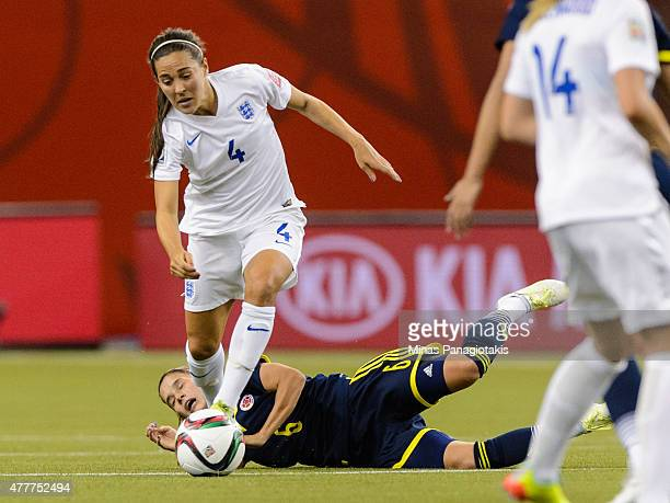 Daniela Montoya of Colombia falls behind Fara Williams of England during the 2015 FIFA Women's World Cup Group F match at Olympic Stadium on June 17...