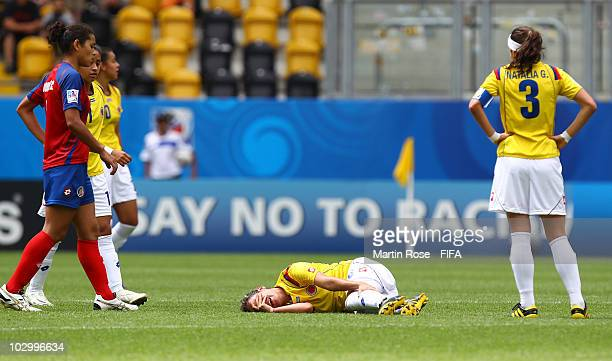 Daniela Montoya of Colombia lies injured on the field during the 2010 FIFA Women's World Cup Group C match between Costa Rica and Colombia at the...