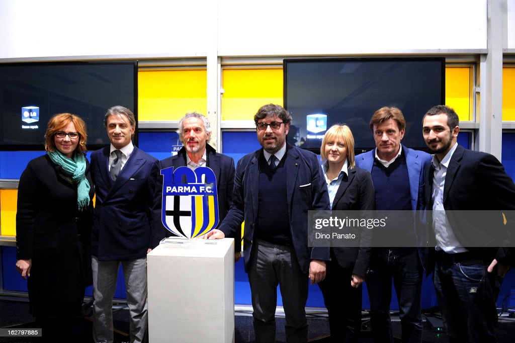 Daniela Moretti of Parma Brand, Alberto Di Chiara of Parma Radio, Parma FC head coach Roberto Donadoni, Pietro Leonardi general manager of Parma FC, Maria Luisa Rancati manager press office Parma FC, Marco Marchi of Parma Brand and Antonio Morgani Web design pose with new logo at an event to unveil the FC Parma centenary logo at Stadio Ennio Tardini on February 27, 2013 in Parma, Italy.