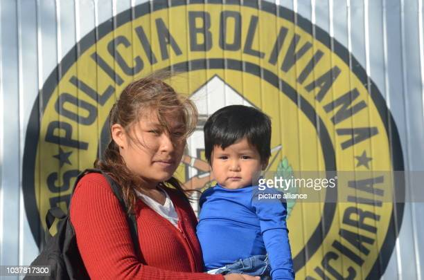 Daniela Rodriguez and her son Neymar wait in front of the infamous Palmasola prison inSanta Cruz Bolivia 09 July 2015 to visit Neymar's father who...
