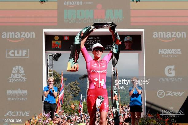 Daniela Ryf of Switzerland celebrates after setting the course record of 82616 to win the IRONMAN World Championships brought to you by Amazon on...