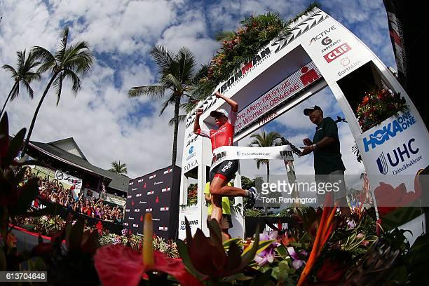 Daniela Ryf of Switzerland celebrates after winning the Women's Pro 2016 IRONMAN World Championship triathlon on October 8 2016 in Kailua Kona Hawaii