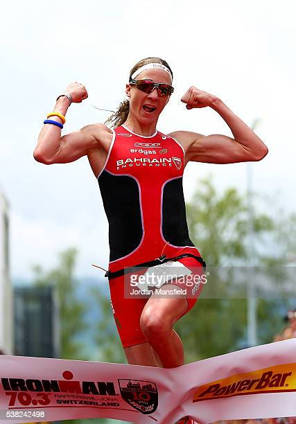 Daniela Ryf of Switzerland celebrates as she crosses the line to win the RapperswillJona Ironman on June 5 2016 in Rapperswil Switzerland