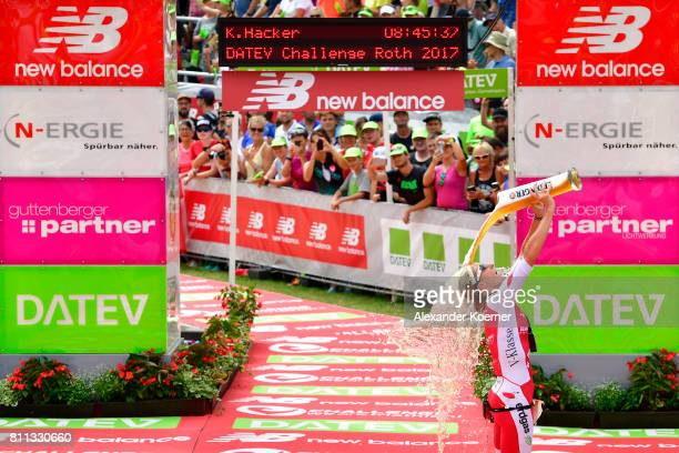 Daniela Ryf of Switzerland celebrates her first place of the DATEV Challenge Roth 2017 on July 9 2017 in Roth Germany 5000 athletes are competing in...