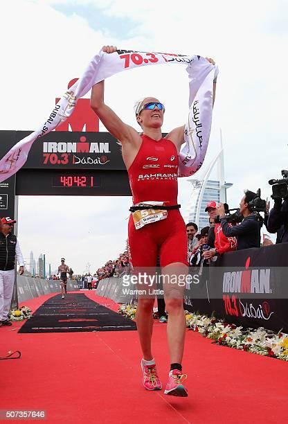 Daniela Ryf of Switzerland celebrates winning the Women's IRONMAN 703 Dubai on January 29 2016 in Dubai United Arab Emirates