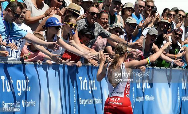 Daniela Ryf of Switzerland celebrates winning the women's race during the Ironman 703 RapperswilJona on June 7 2015 in Rapperswil Switzerland