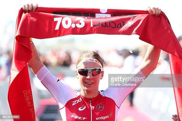 Daniela Ryf of Switzerland celebrates winning the womens race during the Ironman 703 Dubai on January 27 2017 in Dubai United Arab Emirates