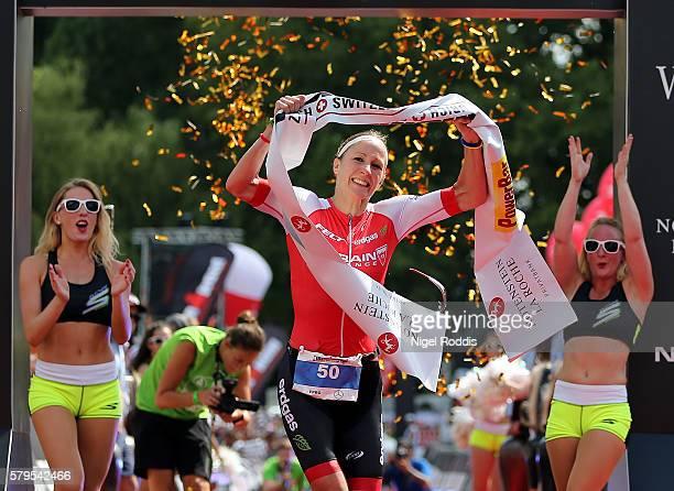 Daniela Ryf of Switzerland celebrates winning the women's race of Ironman Zurich on July 24 2016 in Zurich Switzerland