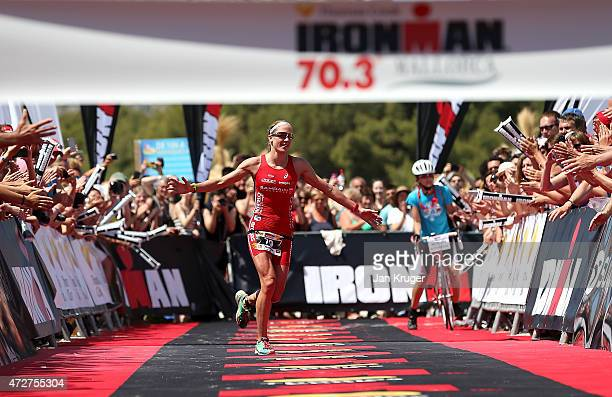 Daniela Ryf of Switzerland crosses the line to win during Ironman 703 on May 9 2015 in Palma de Mallorca Spain