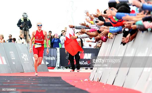 Daniela Ryf of Switzerland is cheered on by the crowd as she wins the Women's IRONMAN 703 Dubai on January 29 2016 in Dubai United Arab Emirates