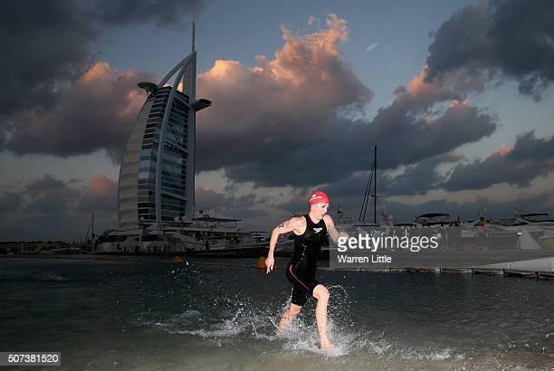 Daniela Ryf of Switzerland leaves the water after the swim en route to winning the Women's IRONMAN 703 Dubai on January 29 2016 in Dubai United Arab...