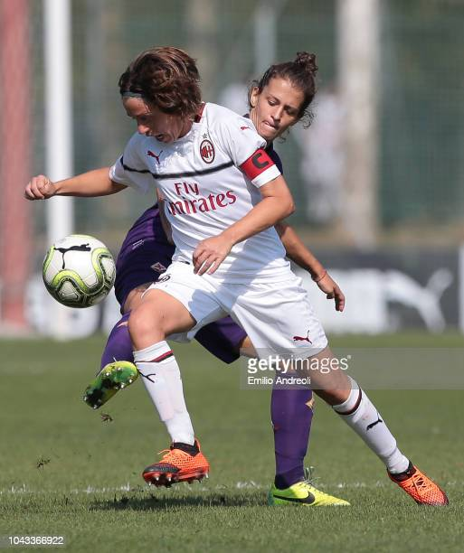 Daniela Sabatino of AC Milan is challenged by Alice Tortelli of Fiorentina Women's FC during the Serie A match between AC Milan Women and Fiorentina...