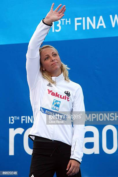 Daniela Samulski of Germany receives the silver medal during the medal ceremony for the Women's 50m Backstroke Final during the 13th FINA World...