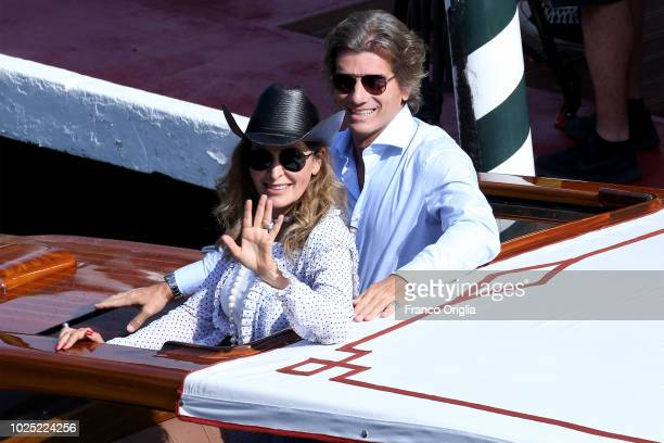 Daniela Santanche and Dimitri Kunz leave the Excelsior Hotel during the 75th Venice Film Festival on August 30 2018 in Venice Italy