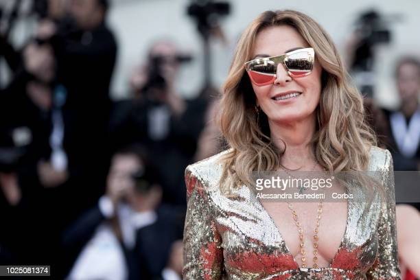 Daniela Santanche walks the red carpet ahead of the opening ceremony and the 'First Man' screening during the 75th Venice Film Festival at Sala...