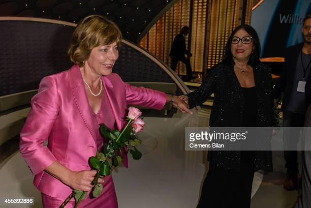 Daniela Schadt and Nana Mouskouri pose after the 'Willkommen bei Carmen Nebel' show at Velodrom on September 13 2014 in Berlin Germany