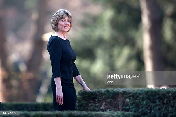 Daniela Schadt, the partner of new German president stands in the garden of the Bellevue Presidential Palace, after the welcome with military...