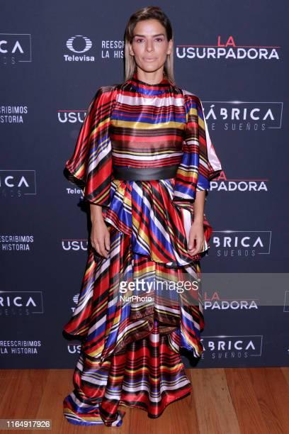 Daniela Schmidt poses for photos during a red carpet of premiere 'La Usurpadora' Tv Screening soap opera at Club de Banqueros on August 29 2019 in...