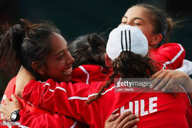 Daniela Seguel and Barbara Gatica of Chile celebrate with teammates during the first day of the Tennis Fed Cup American Zone Group 1 at Club...