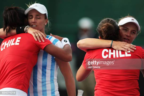 Daniela Seguel and Barbara Gatica of Chile greet Nadia Podoroska and Maria Irigoyen of Argentina during the first day of the Tennis Fed Cup American...
